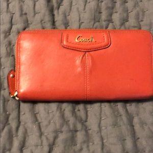 Coral coach accordion wallet